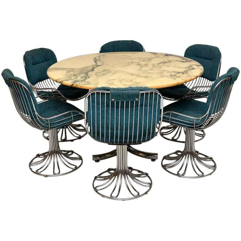 retro marble and chrome dining table with six chrome swivel chairs