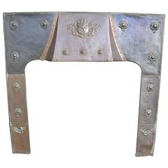 Large Arts and Crafts Copper Fire Insert with a Lion in a Shield Crest