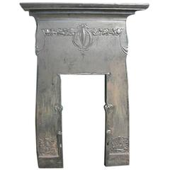 Arts & Crafts Cast Iron Fireplace with Stylized Floral Details