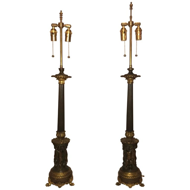 Magnificent Pair of Bronze Lamps with Figures
