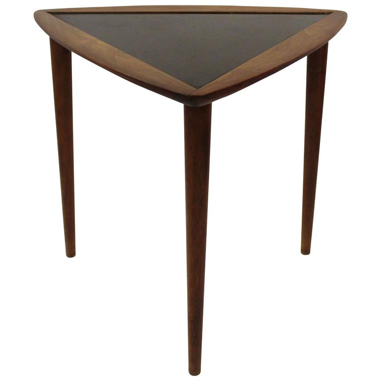Triangular side table with painted black top for sale at