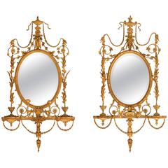 Pair of Early 19th Century English Adams Oval Giltwood Girandole Mirrors