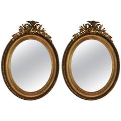 Pair of 19th Century Oval Giltwood/Gesso Carved Frames with Mirror Inserts