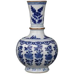 Chinese Porcelain Underglaze Blue and White Moulded Bottle Vase, 17th Century