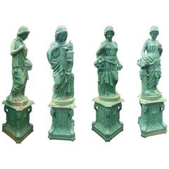 Impressive Set of Four Seasons Cast Iron Statues on Pedestal Bases