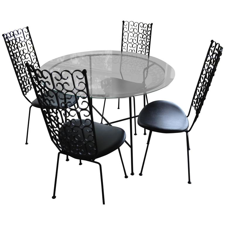 Arthur umanoff wrought iron patio set table and four for Metal patio table and 4 chairs