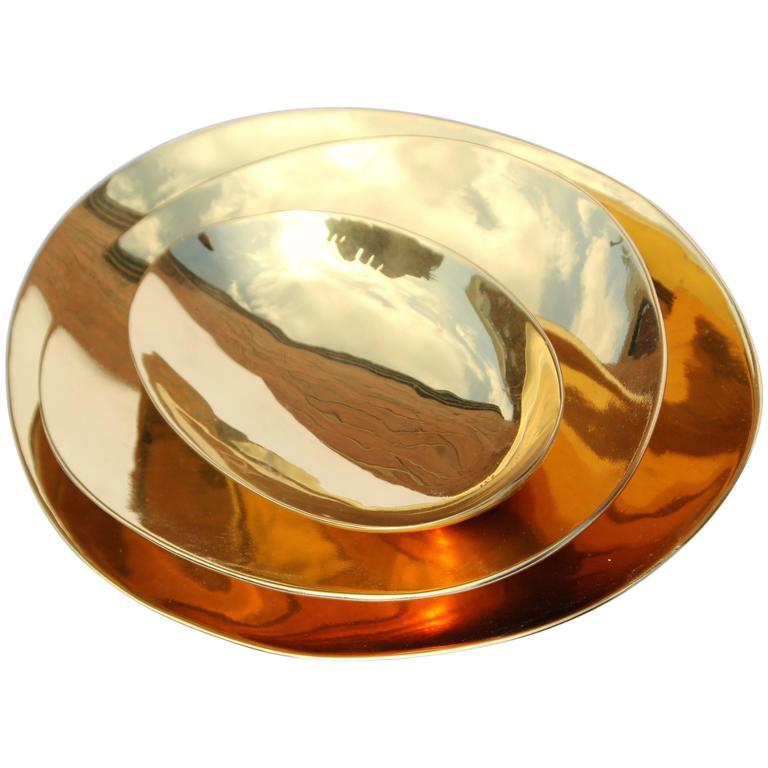 Set of Handmade Cast Brass Plates For Sale