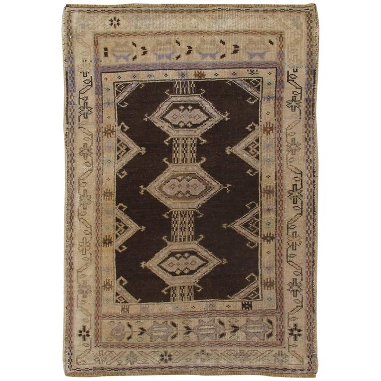 Vintage Turkish Oushak Carpet In Various Shades Of Brown And Grey For
