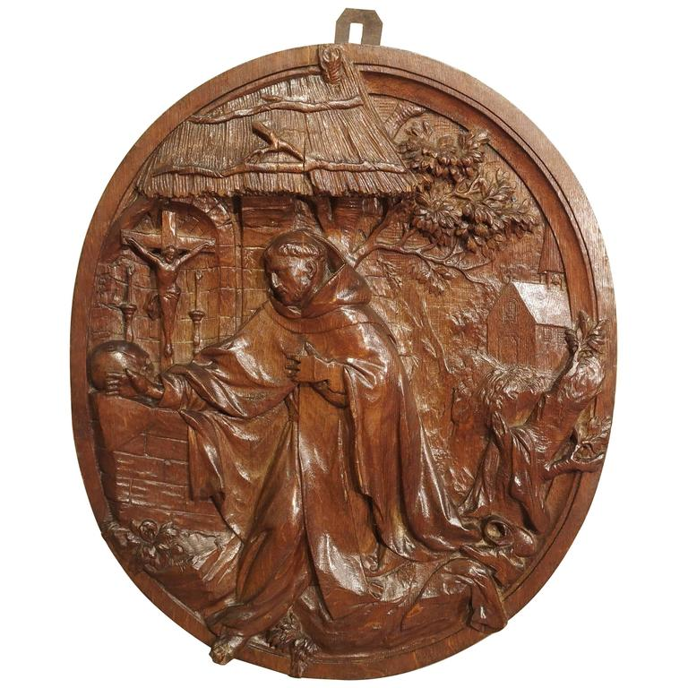Carved 18th Century Oval Wooden Religious Plaque from France For Sale