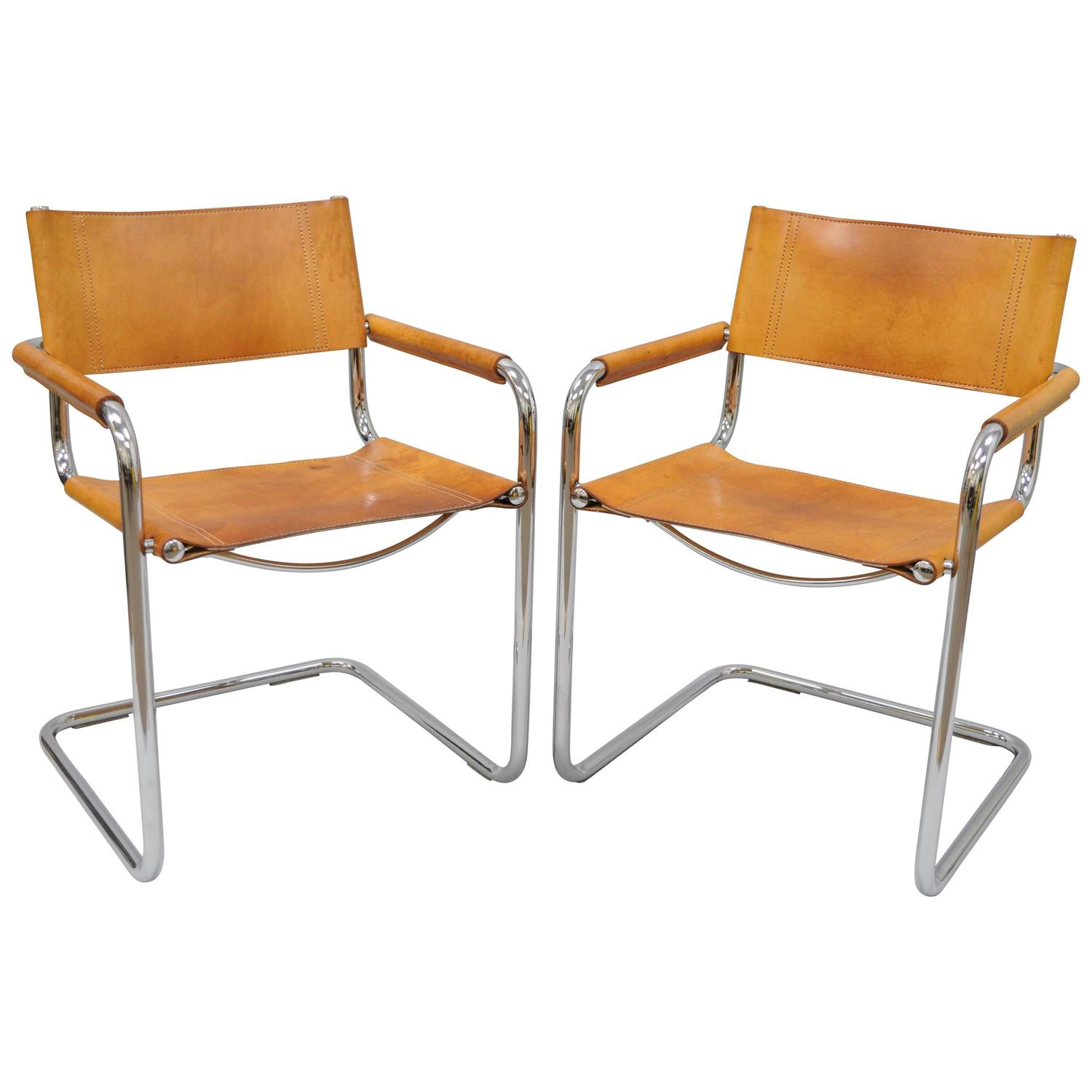 Of four chairs in oak and patinated cognac leather for sale at 1stdibs - Pair
