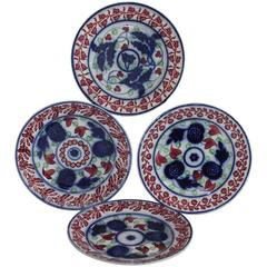 Set of Four 19th Century Cut Sponge Plates