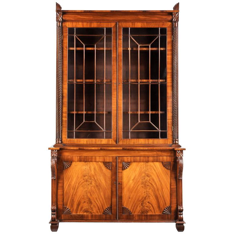 Regency Period Mahogany Bookcase With Matching Flared Panels To The Bottom Doors For