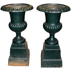 Pair of Green Painted Victorian Iron Urns on Attached Bases