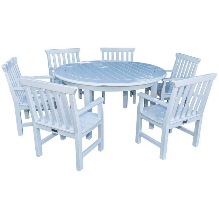 Isro Round Dinning Table And Six Armchairs By Weatherend For