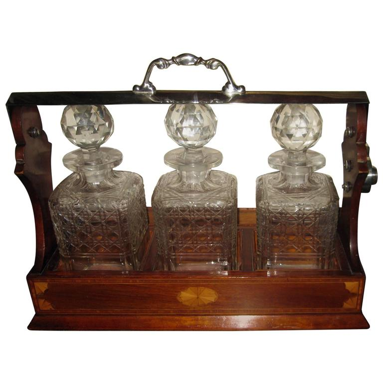 19th Century Georgian Inlaid Mahogany Tantalus with Three Decanters For Sale