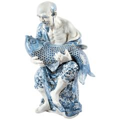 Blue and White Chinese Porcelain Man and Fish Sculpture
