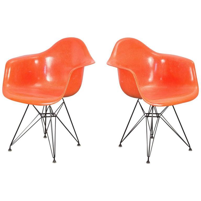 Pair of Orange Eames Armchair Shells