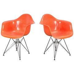 Pair of Orange Eames Armchair Shells