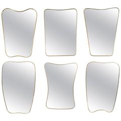 Collection of Six Brass Framed Wall Mirrors in the Style of Gio Ponti