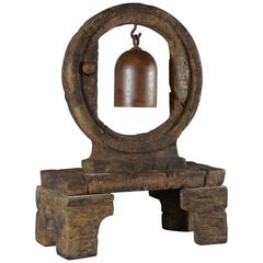 Resonant Iron Bell Suspended in Large Cast Stone Wheel on Stand