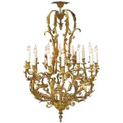 Early 20th Century French Louis XIV Bronze Doré Foliate and Putti Chandelier
