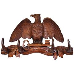 Antique Hand-Carved Small Black Forest Coat or Key Rack with Eagle Holding a Key