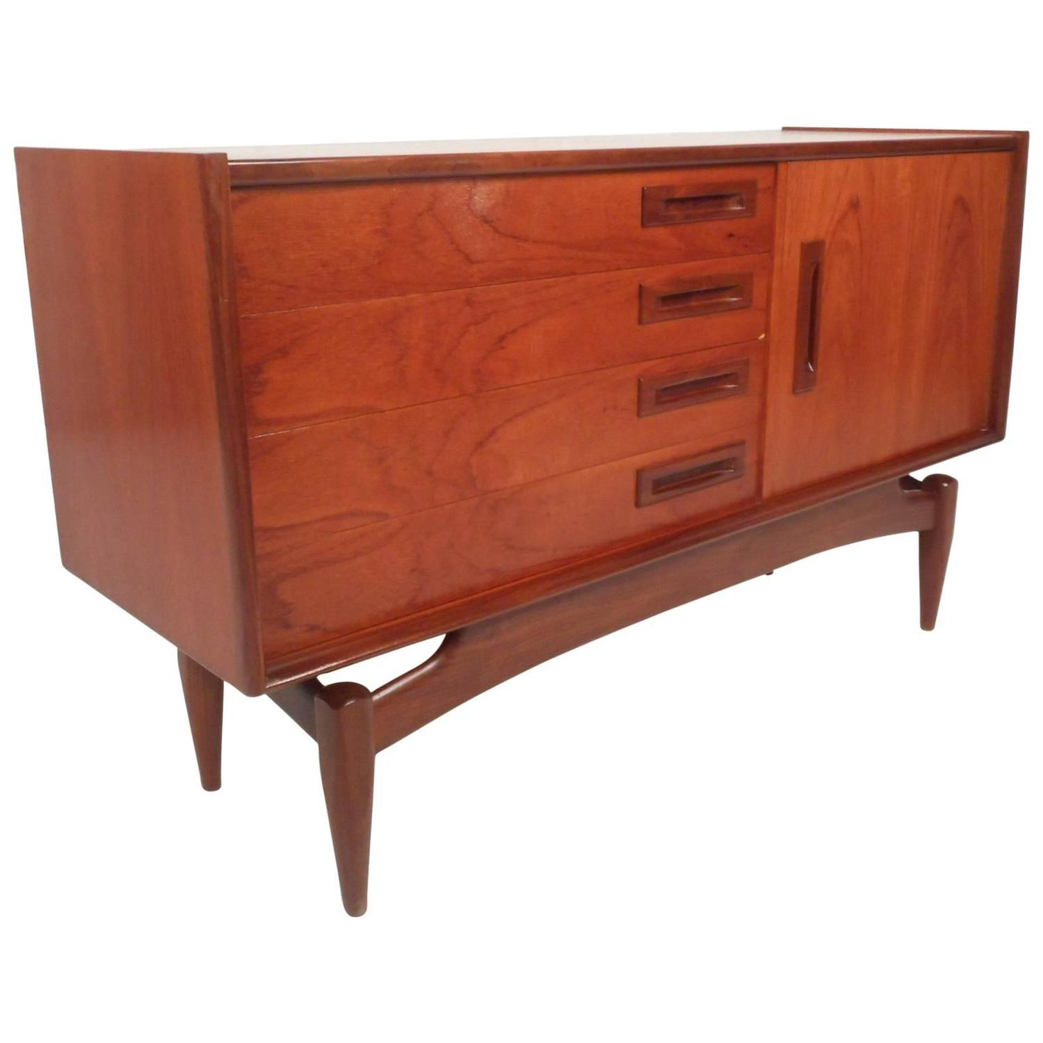 Small Mid Century Modern Credenza With A Sculpted Base For Sale At 1stdibs