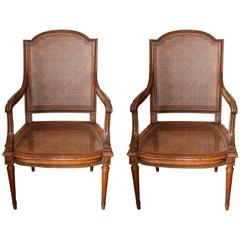 Pair of Louis XVI Style Hand-Caned and Carved Mahogany Armchairs with Leather