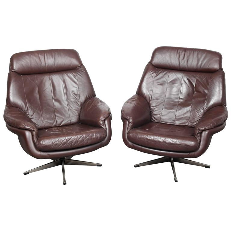Pair of danish mid century modern leather swivel lounge for Danish modern reproduction