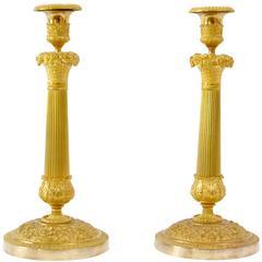 Pair of Gilt Bronze Empire Candlesticks