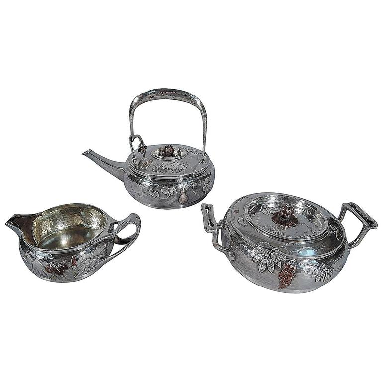 Rare Tiffany Japonesque Hand-Hammered Sterling Silver and Mixed Metal Tea Set