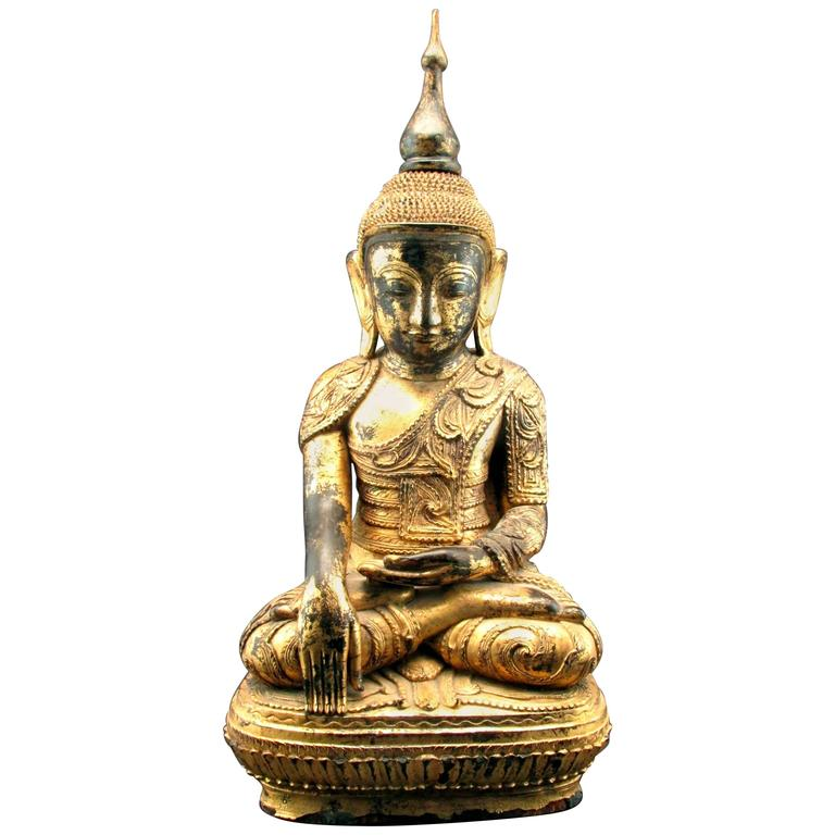 A Finely Carved and Gilded 19th Century Giltwood Burmese Buddha