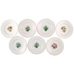 Seven Antique Royal Copenhagen Plates in Flora Danica Style