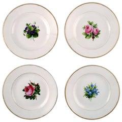 Four Antique Royal Copenhagen Flat Plates in Flora Danica Style