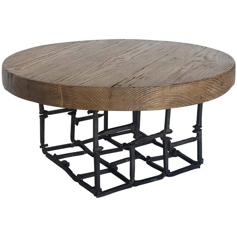 round reclaimed wood and iron spike cocktail table for With round wood and iron coffee table