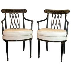 Pair of Black Lacquered & Gold Decorated Diamond Back Regency Open Armchairs