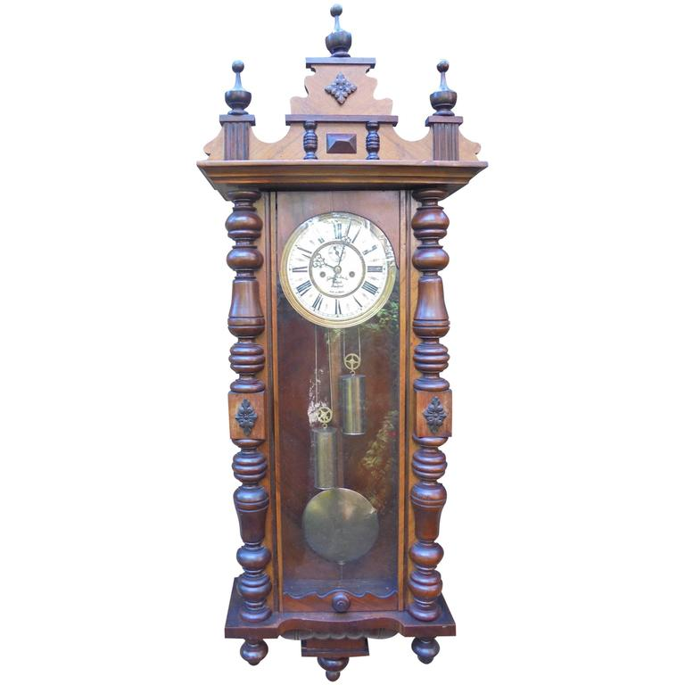 antique walnut cased double weight vienna wall clock
