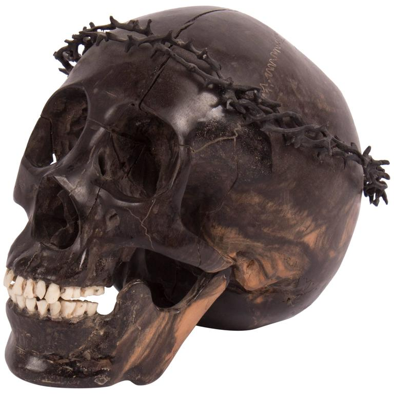 Carved wooden skull with crown of thorns at stdibs