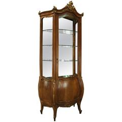 Antique French Louis XIV Style Mahogany and Gilt Bombe Mirror Back Vitrine