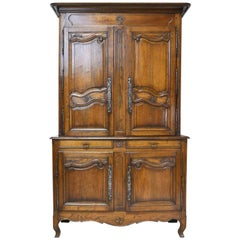18th Century Tall French Buffet a Deux Corps in Oak with Hand-Carved Panels