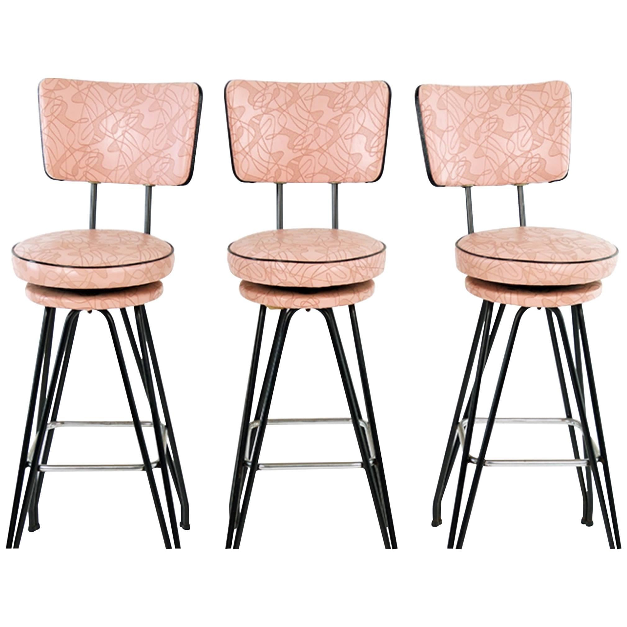 Set of Three Kitch Mid-Century Bar Stools with Pink Upholstery, Black Piping