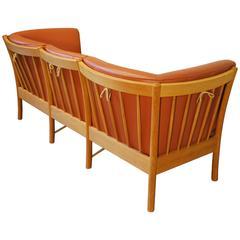 Danish Modern Leather Sofa by Hurup with a Shaped Oak Frame
