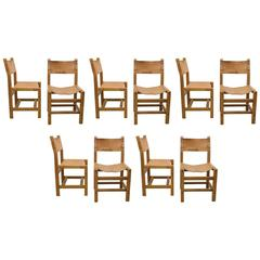 Set of Ten Solid Elm and Cognac Leather Chairs Designed by Pierre Chapo