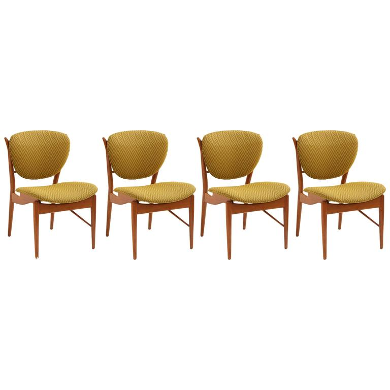 Four Finn Juhl Sculpted Teak Dining Chairs