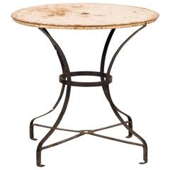 An Early 20th Century Round Top Garden Table with Metal Base