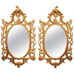 18th Century carved oval giltwood mirrors