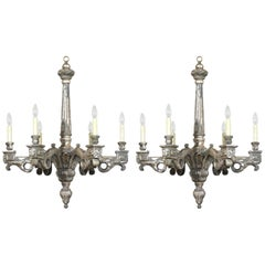 Pair of Six-Light Italian Neoclassical-Style Silver Leaf Carved Wood Chandeliers
