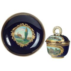 Meissen Dresden Pattern Covered Cobalt Blue and Gilt Demitasse Cup and Saucer