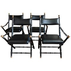 Two Black Leather Campaign Chairs in the Style of Maison Jansen