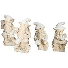 Group of Four French Carved Limestone Gnomes from the Early 1900s